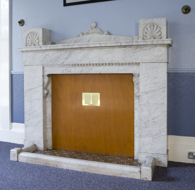 Interior. Detail of library fireplace