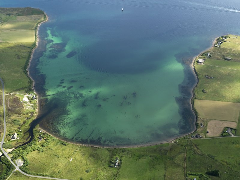 Oblique aerial view centred on Mill Bay on Hoy with possible submerged features visible, taken from the WSW.