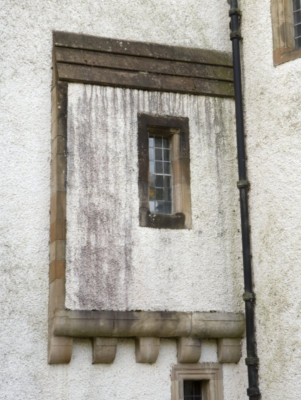 Detail of corbelled projection and window