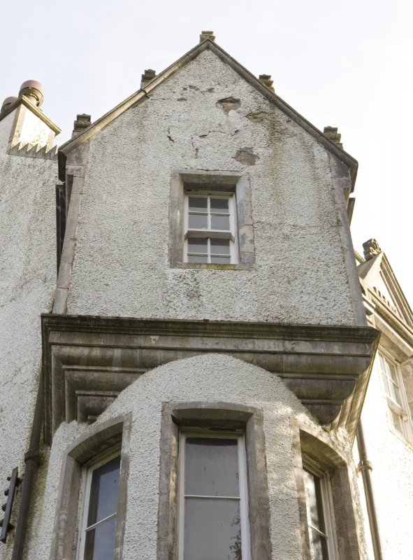 Detail of corner oriel with corbelled gable over