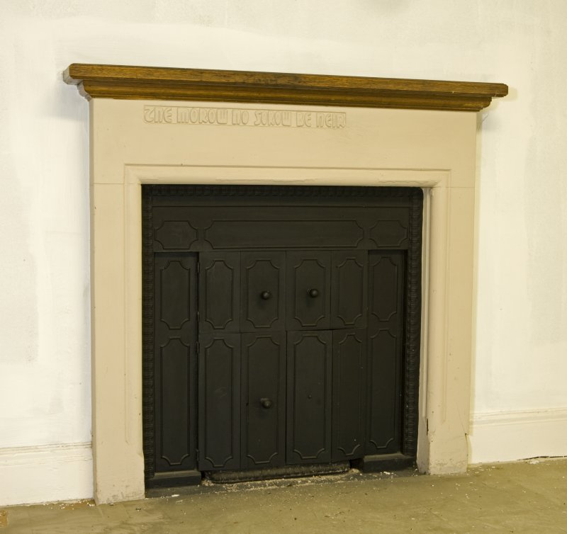 Interior. First floor detail of fireplace (doors closed)