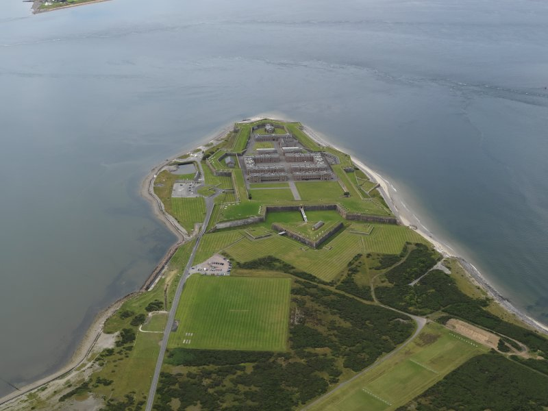 General oblique aerial view centred on the fortifications, taken from the ENE.