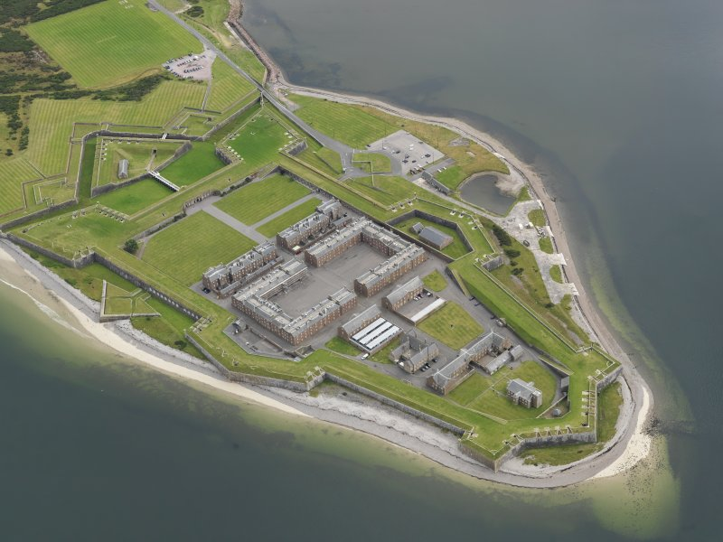 Oblique aerial view centred on the fortifications, taken from the WNW.