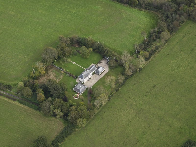 Oblique aerial view centred on the house, taken from the WSW.