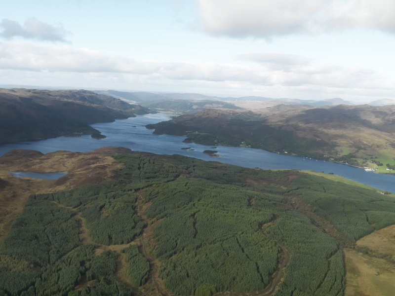 Oblique aerial view looking from Badlia Hill towards the Kyles of Bute, taken from the SW.