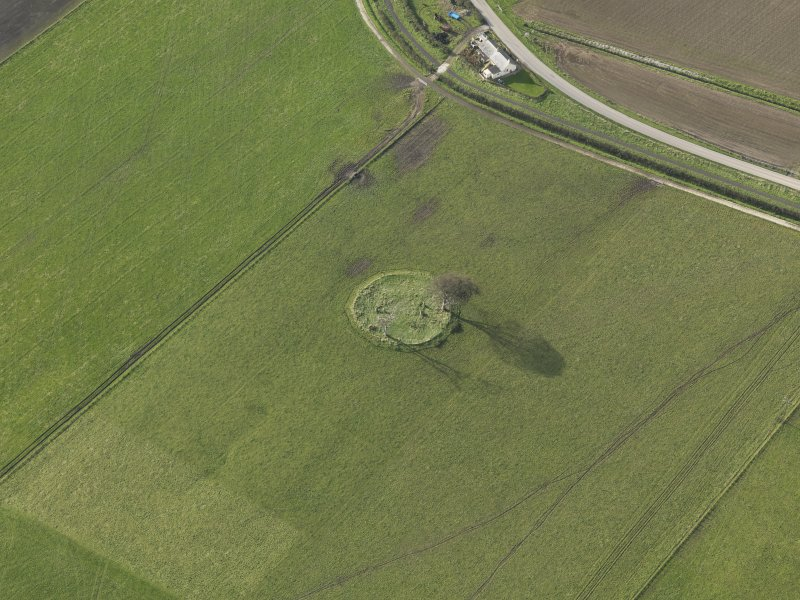 Oblique aerial view centred on the stone circle, taken from the E.