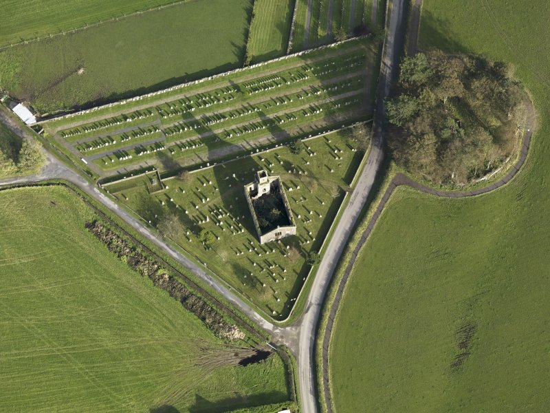 Oblique aerial view centred on the earthwork and church, taken from the WSW.