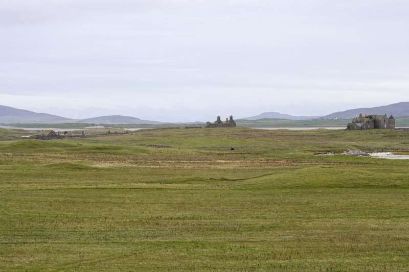 Distant view across Vallay, showing Old Vallay House and Chamberlain's House to centre, Vallay Farmstead to left and Vallay House to right, taken from W