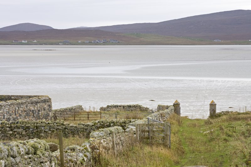 View to N Uist from the driveway of Old Vallay House and the Chamberlain's house,  with the SE gatepiers and Vallay Strand in the foreground, taken from NW