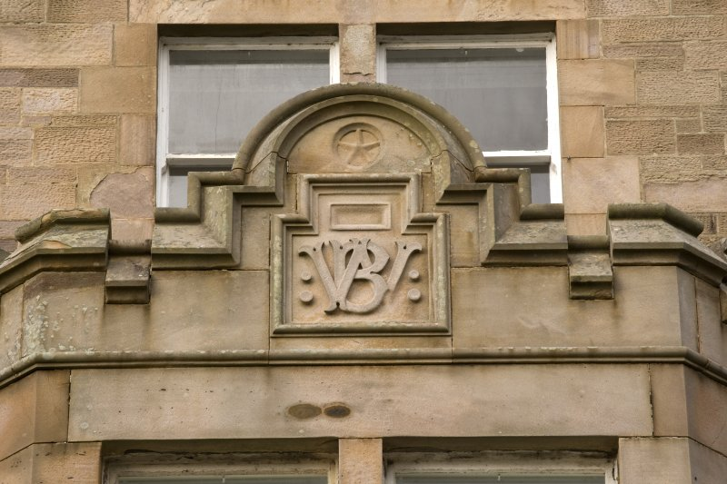 Detail of plaque above bay on S facade (William Barclay)