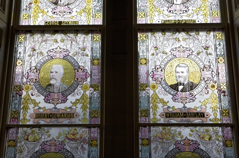 Interior. W staircase, stained glass window, detail of benefactors, Robert Duncanson and William Barclay