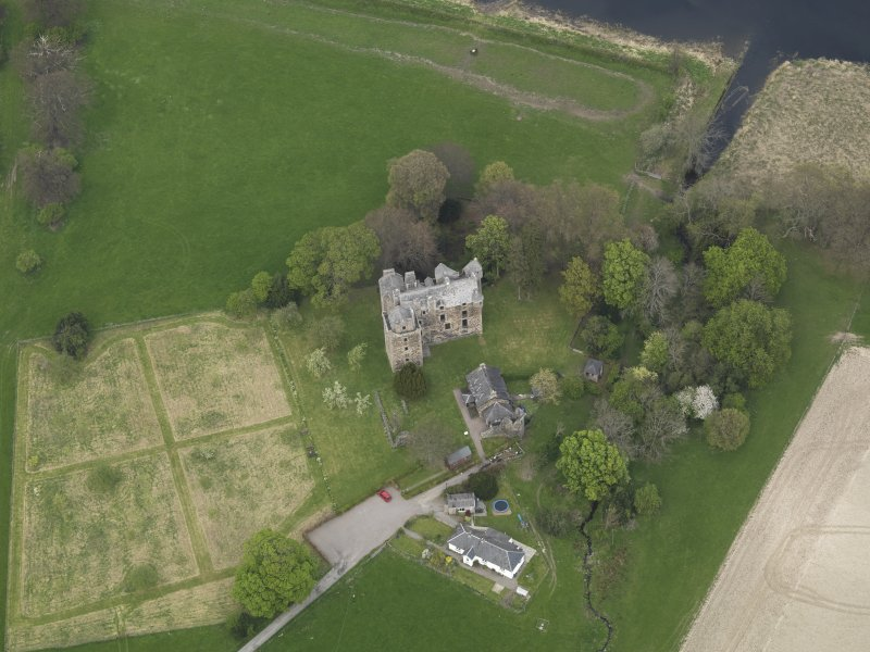 Oblique aerial view centred on the castle with the custodian's house adjacent, taken from the S.