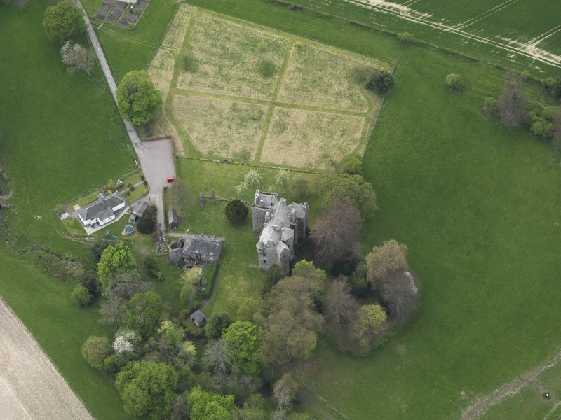Oblique aerial view centred on the castle with the custodian's house adjacent, taken from the ENE.