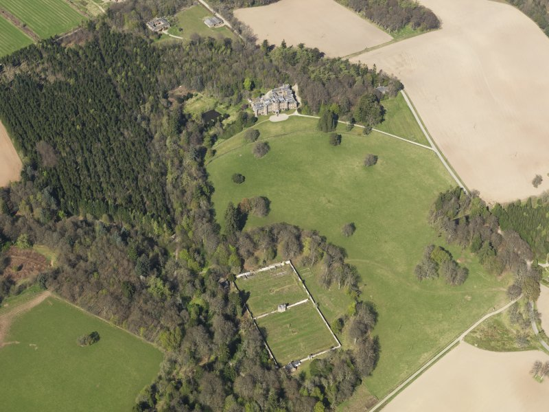 Oblique aerial view of the country house with the walled garden adjacent, taken from the S.