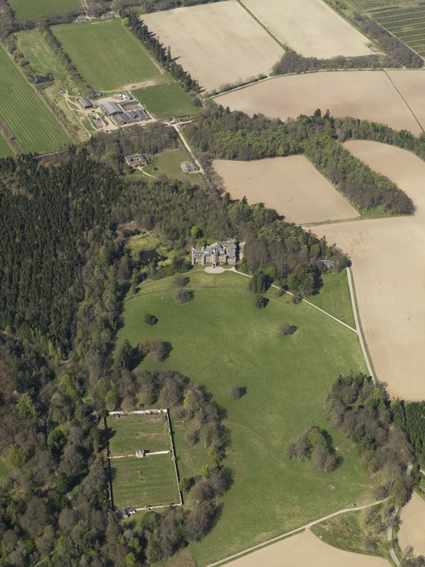 Oblique aerial view of the country house with the walled garden adjacent, taken from the SSE.