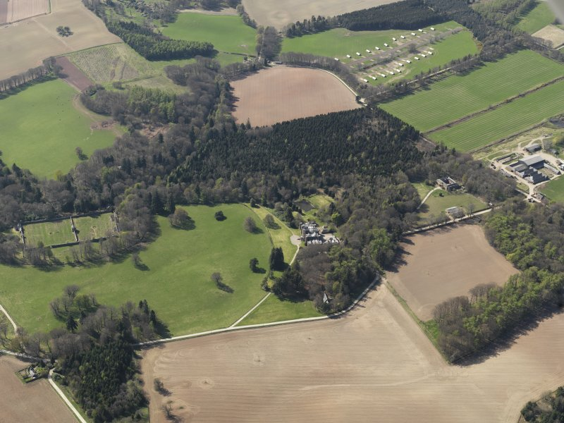 General oblique aerial view of the country house with the walled garden adjacent, taken from the E.