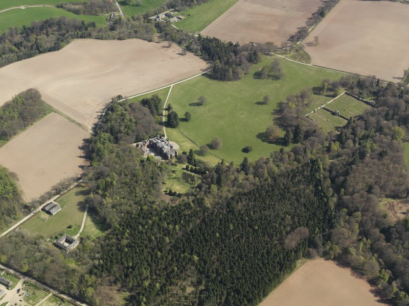 General oblique aerial view centred on the country house, taken from the NW.