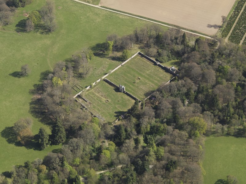 Oblique aerial view centred on the walled garden, taken from the NW.