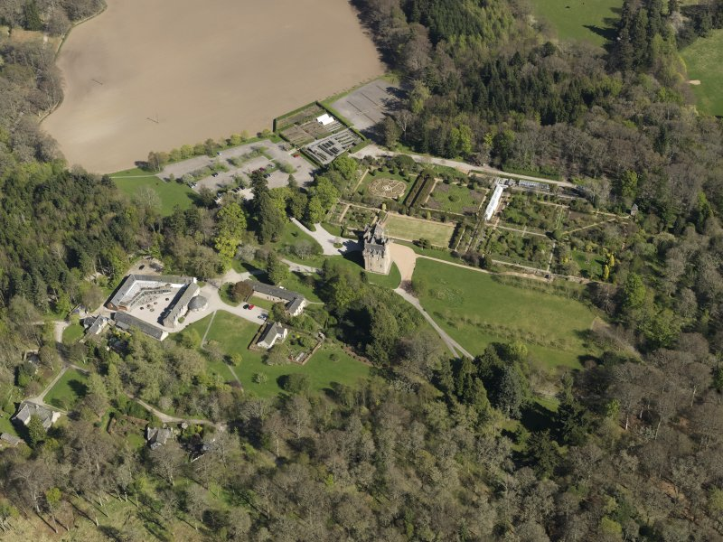 Oblique aerial view centred on the castle with the garden adjacent, taken from the NW.