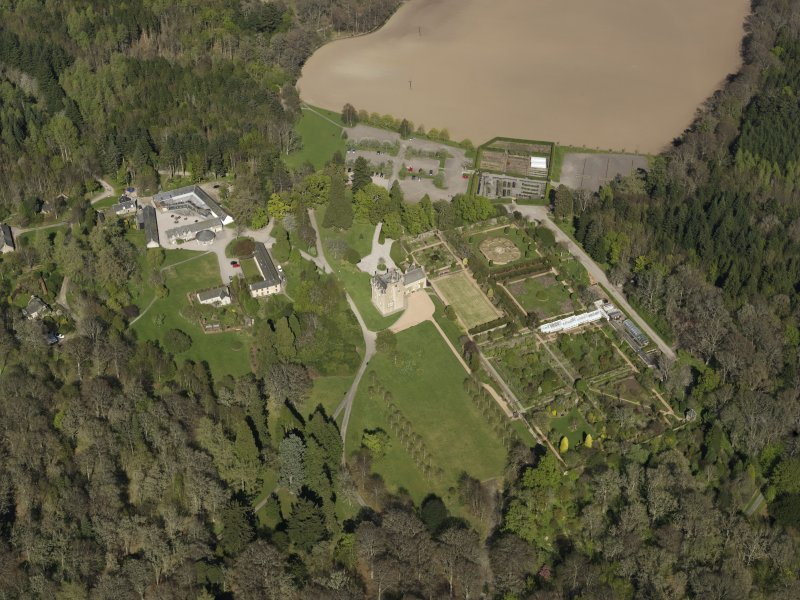 Oblique aerial view centred on the castle with the garden adjacent, taken from the SW.