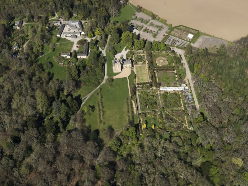 Oblique aerial view centred on the castle with the garden adjacent, taken from the SSW.