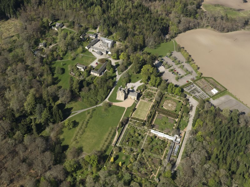 Oblique aerial view centred on the castle with the garden adjacent, taken from the SSE.