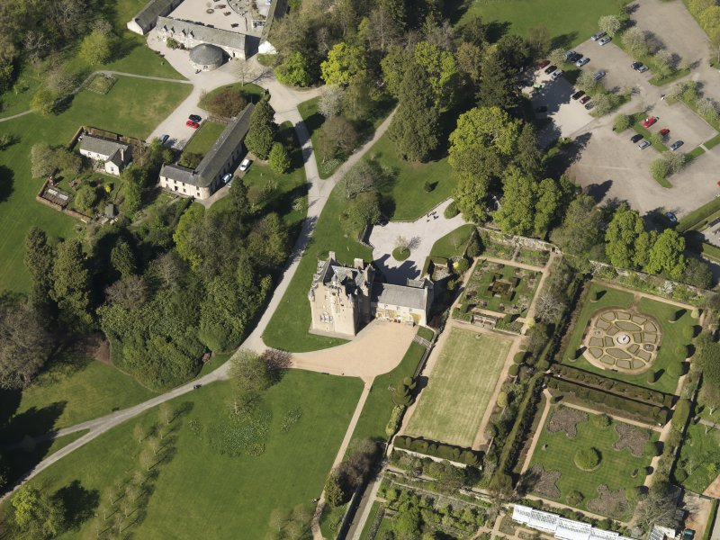 Oblique aerial view centred on the castle with the garden adjacent, taken from the S.