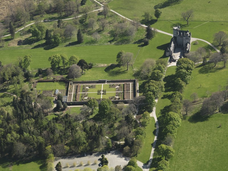 Oblique aerial view centred on the walled garden with the castle adjacent, taken from the ENE.