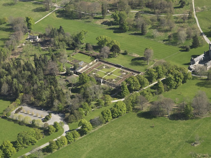 Oblique aerial view centred on the walled garden, taken from the NNW.