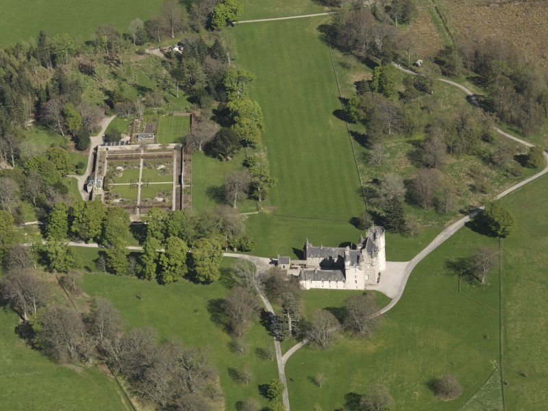 Oblique aerial view centred on the castle with the walled garden adjacent, taken from the WSW.
