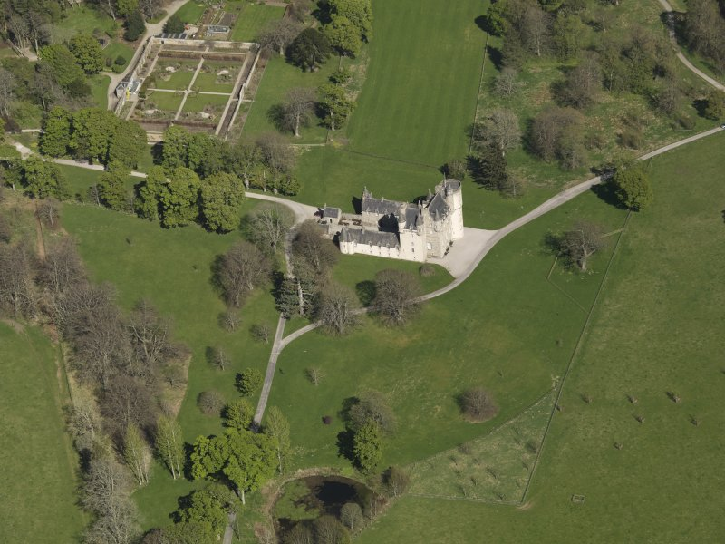 Oblique aerial view centred on the castle with the walled garden adjacent, taken from the SW.