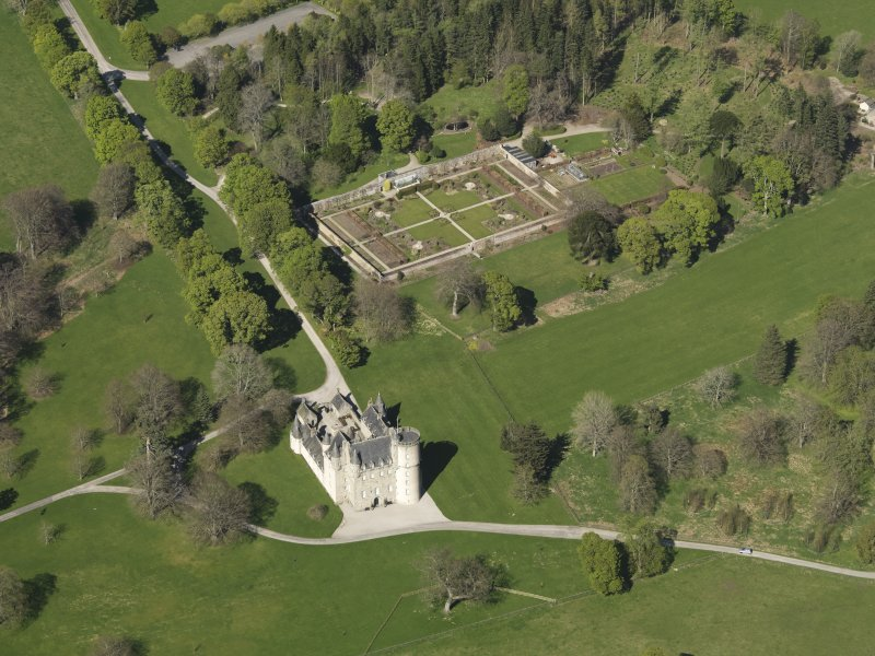 Oblique aerial view centred on the castle with the walled garden adjacent, taken from the SSW.