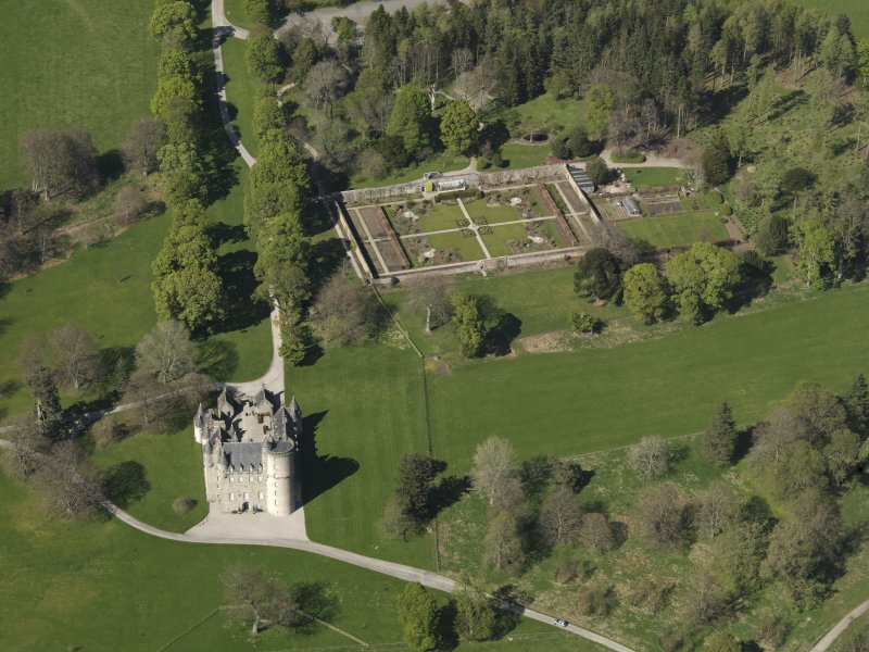 Oblique aerial view centred on the castle with the walled garden adjacent, taken from the S.