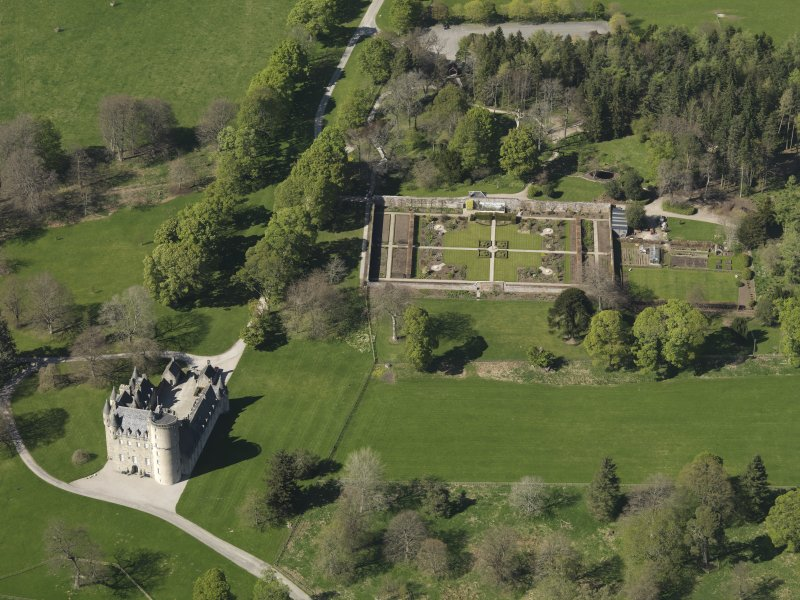 Oblique aerial view centred on the castle with the walled garden adjacent, taken from the SSE.