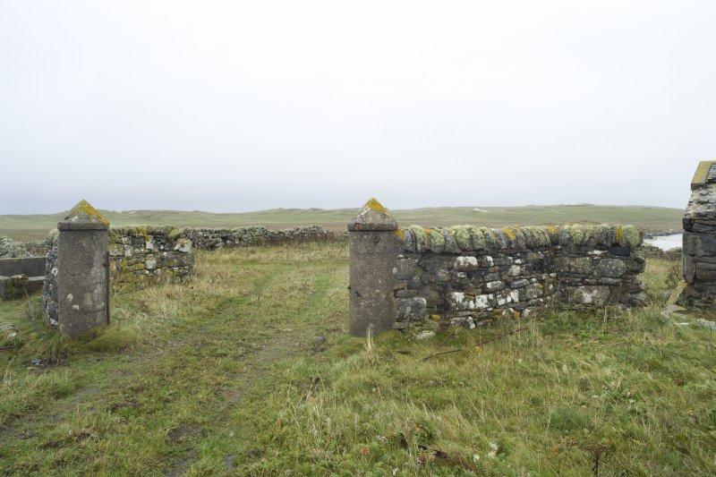 View of boundary wall and gatepiers to NW of Old Vallay House