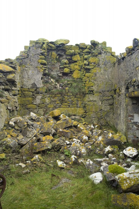 Interior view of the partially collapsed N gable of Old Vallay House, Vallay