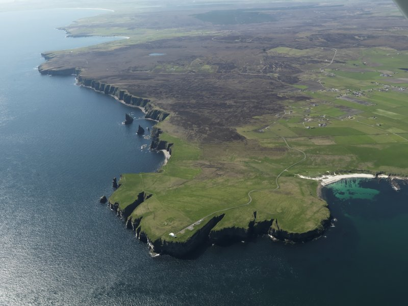 General oblique aerial view of Duncansby Head Lighthouse and the Bay of Sannick, taken from the NE.