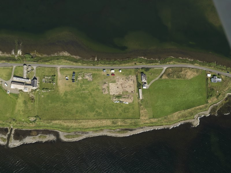 Oblique aerial view centred on the excavations of Brodgar settlement, taken from the SSE.
