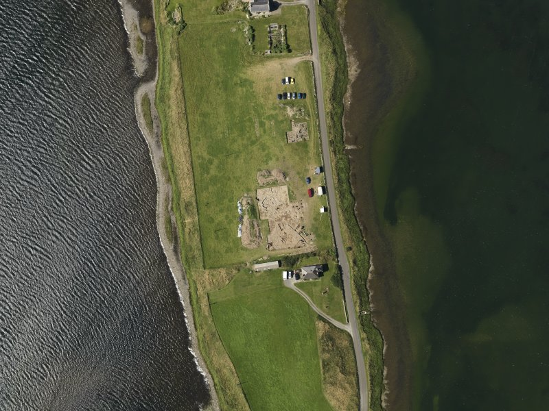 Oblique aerial view centred on the excavations of Brodgar settlement, taken from the SW.