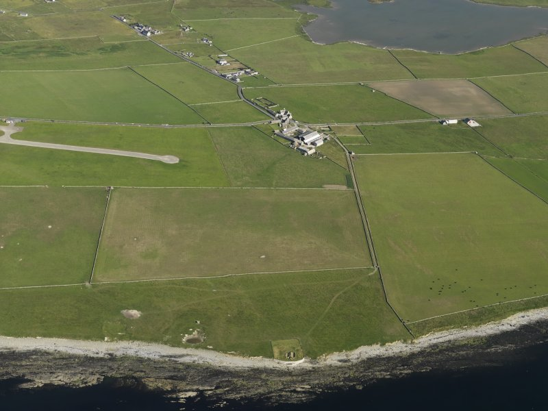 General oblique aerial view centred on Skaill farmstead with the neolithic buildings at the Knap of Howar in the foreground, taken from the NW.