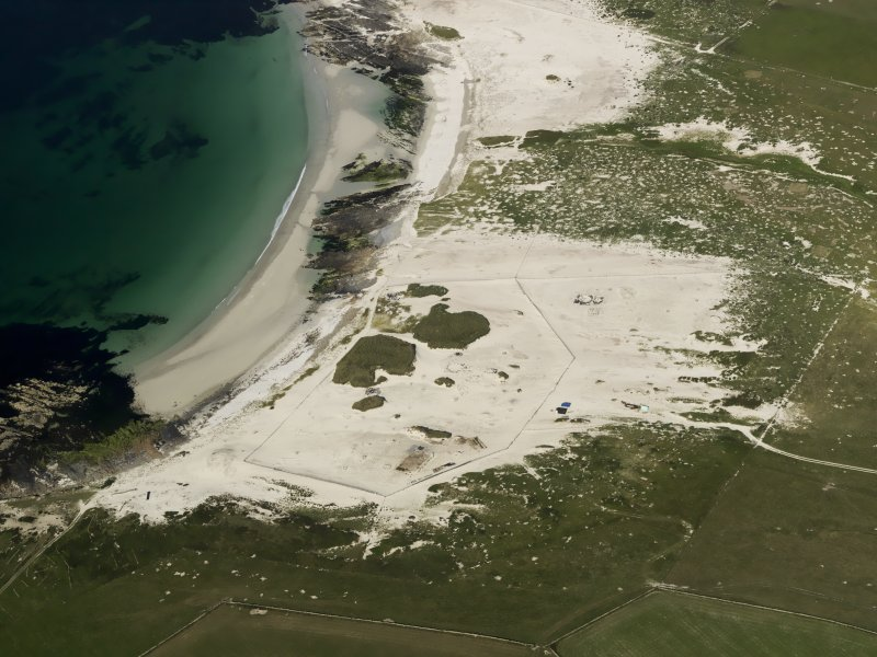 General oblique aerial view of the Links of Noltland showing the 2009 excavation area and the remains of earlier excavations, taken from the SW.