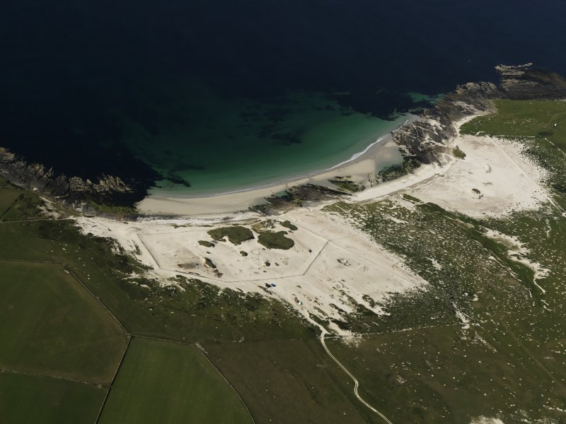 General oblique aerial view of the Links of Noltland showing the 2009 excavation area and the remains of earlier excavations, taken from the S.