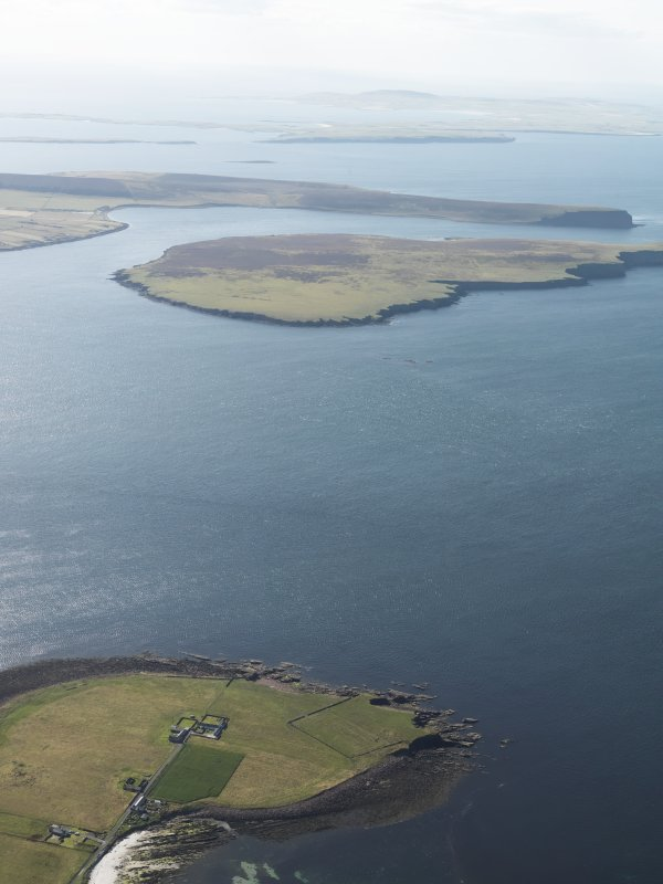 General oblique aerial view looking across the Lashy Sound towards the Calf of Eday, taken from the E.