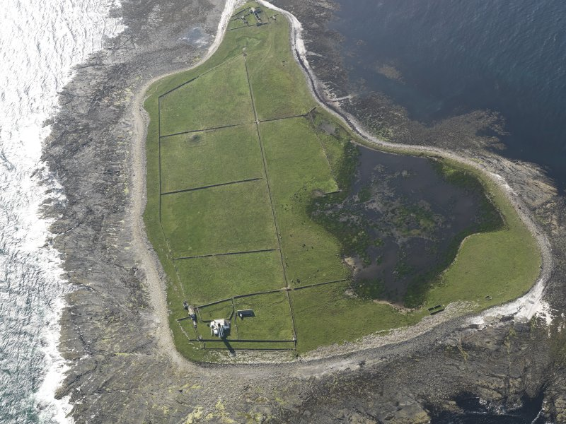Oblique aerial view centred on Start Point lighthouse with Mount Maestry chambered cairn adjacent, taken from the E.