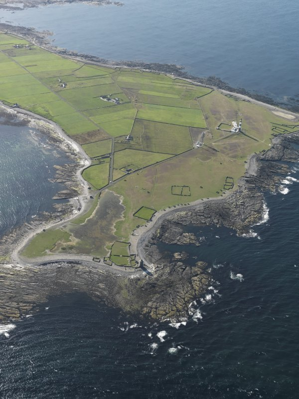 General oblique aerial view centred on the ligthouses of Dennis Ness with enclosures adjacent, taken from the SE.