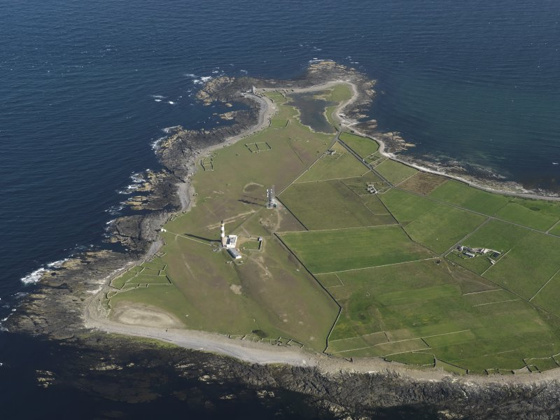 General oblique aerial view centred on the ligthouses of Dennis Ness with enclosures adjacent, taken from the NE.