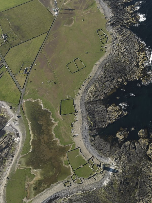 Oblique aerial view centred on the old lighthouse of Dennis Head with enclosures adjacent, taken from the SSE.