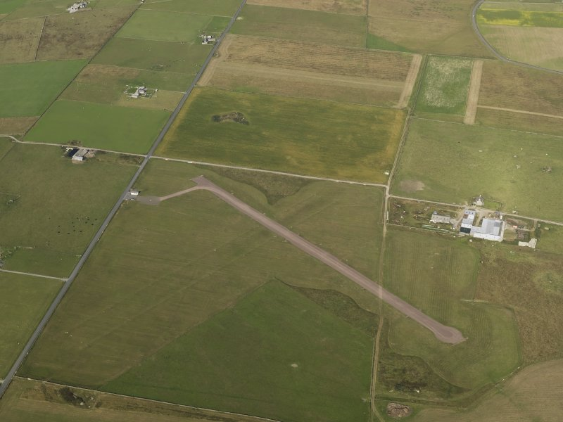 Oblique aerial view centred on Sanday airfield, taken from the W.