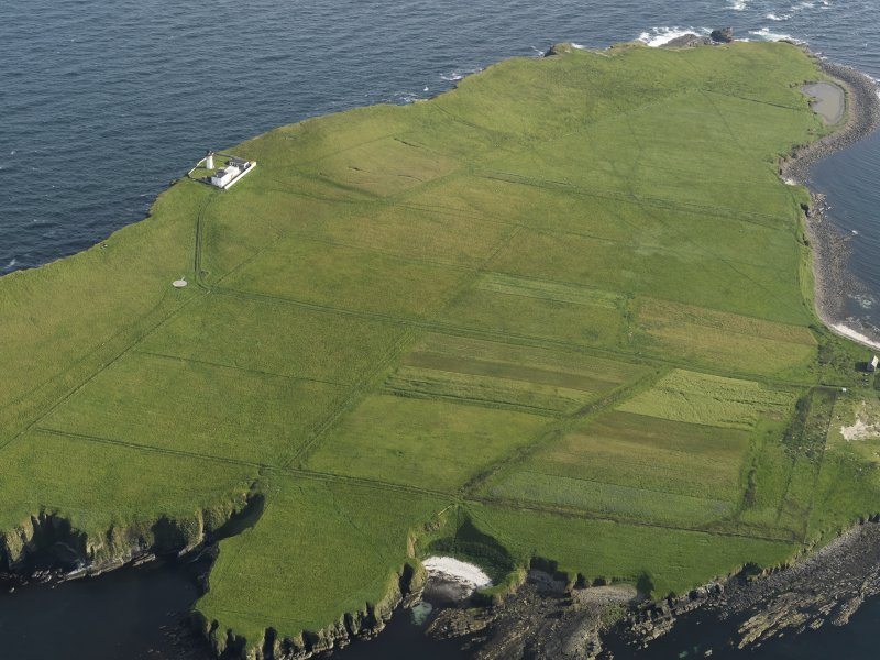 General oblique aerial view of Copinsay showing the lighthouse and field system, taken from the N.