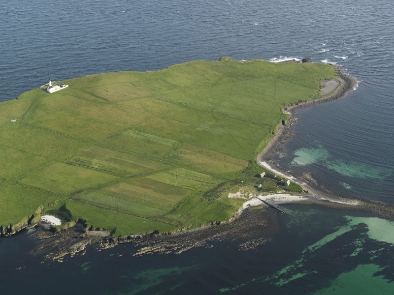Oblique aerial view on Copinsay showing the lighthouse and field system, taken from the N.